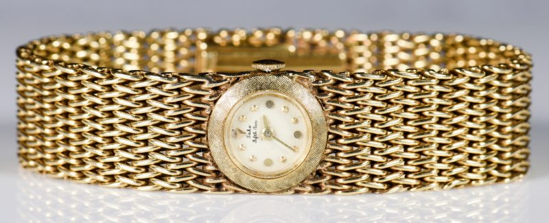 Lot 948: 14K Bracelet Watch, Saks