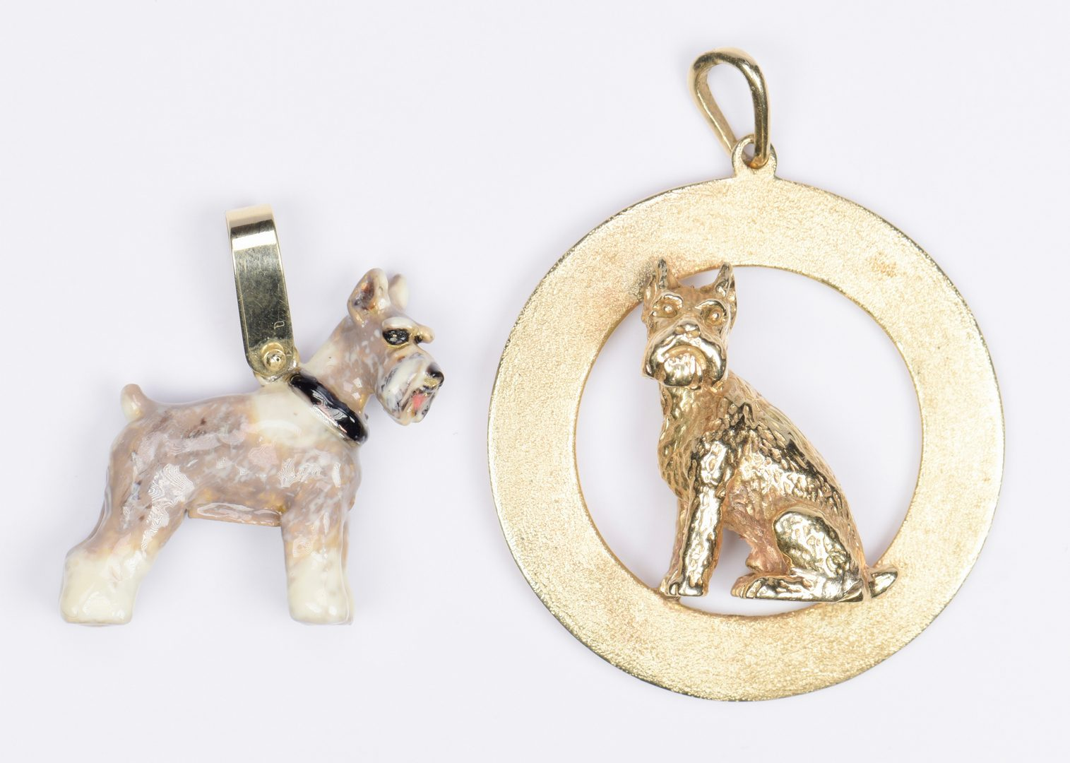Lot 966: 18K Lion; 14K Cat Pin; 14K Dog Charm