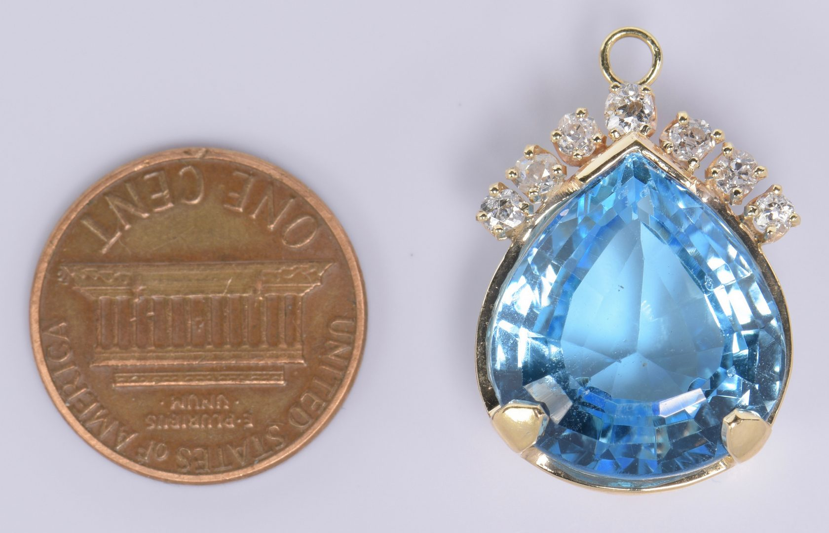 Lot 975: 14K Blue Topaz Pendant