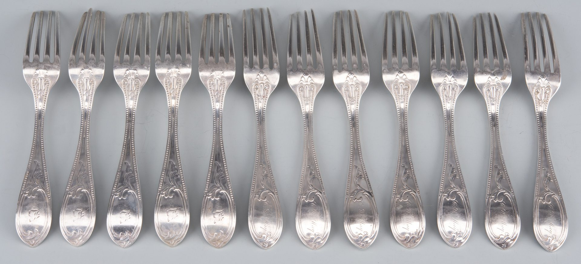 Lot 137: 33 Pcs. Coin and Sterling Flatware inc forks, knives