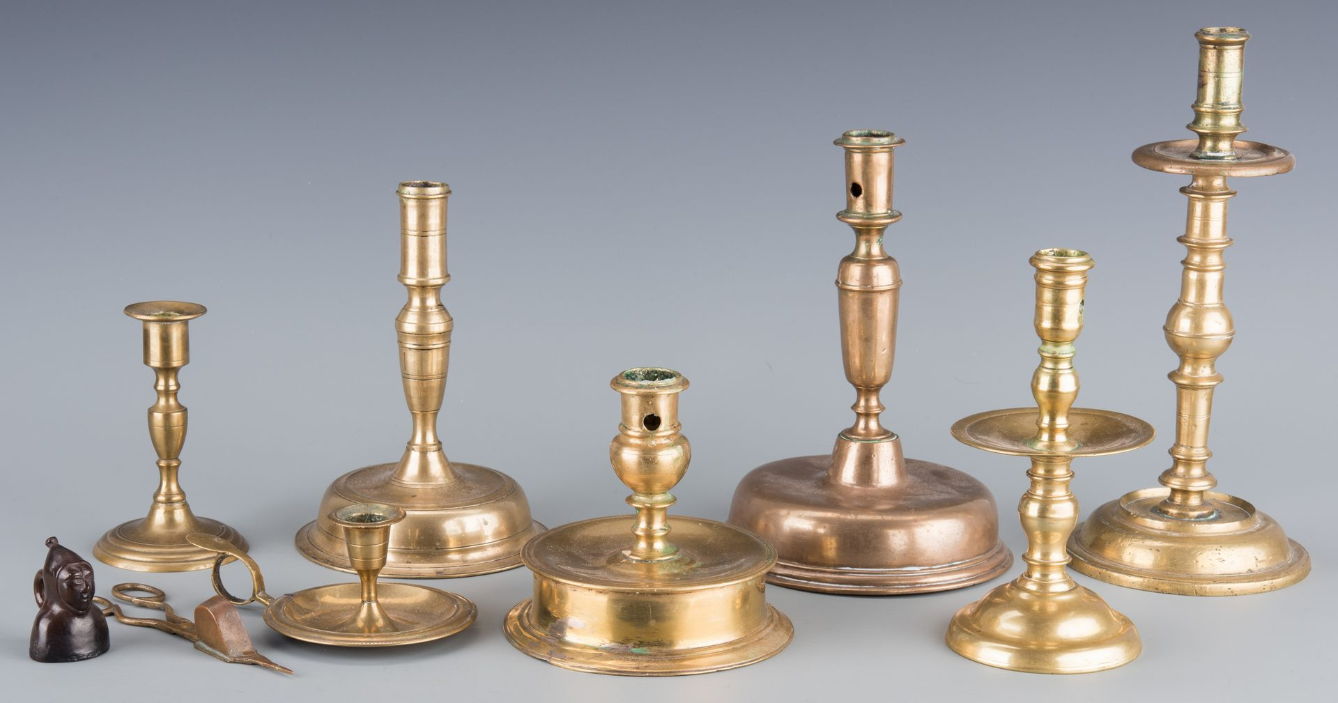 Lot 144: Group early Brass Candlesticks and Horse Brasses