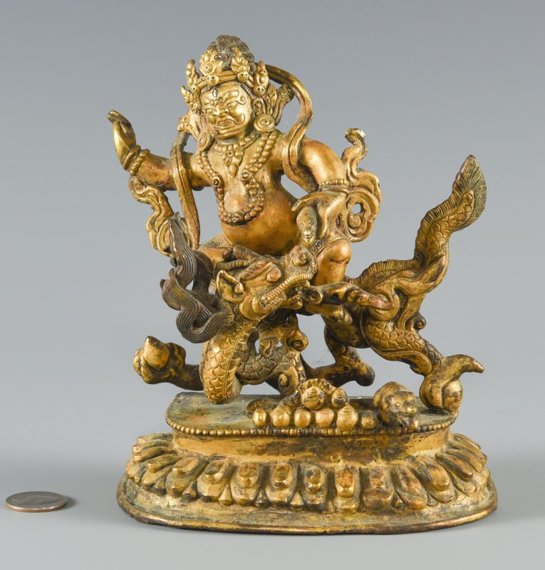 Lot 252: Gilt bronze figure on dragon