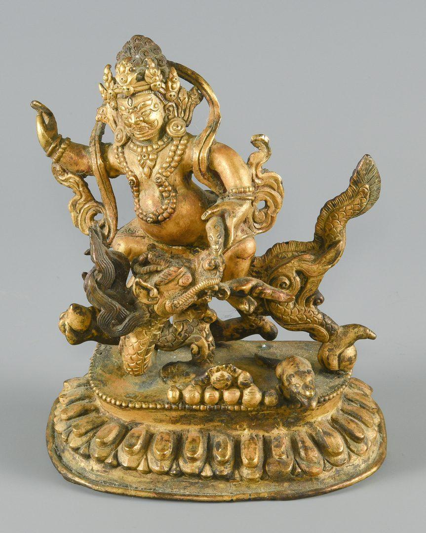 Lot 252: Gilt bronze figure on dragon