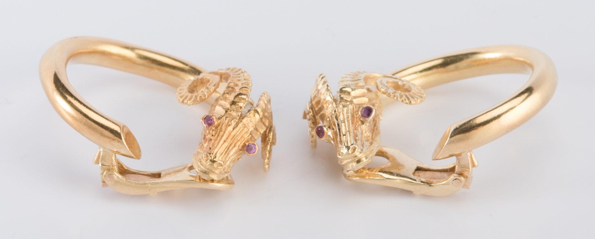 Lot 312: Pair 18K Ram's Head Hoop Earrings