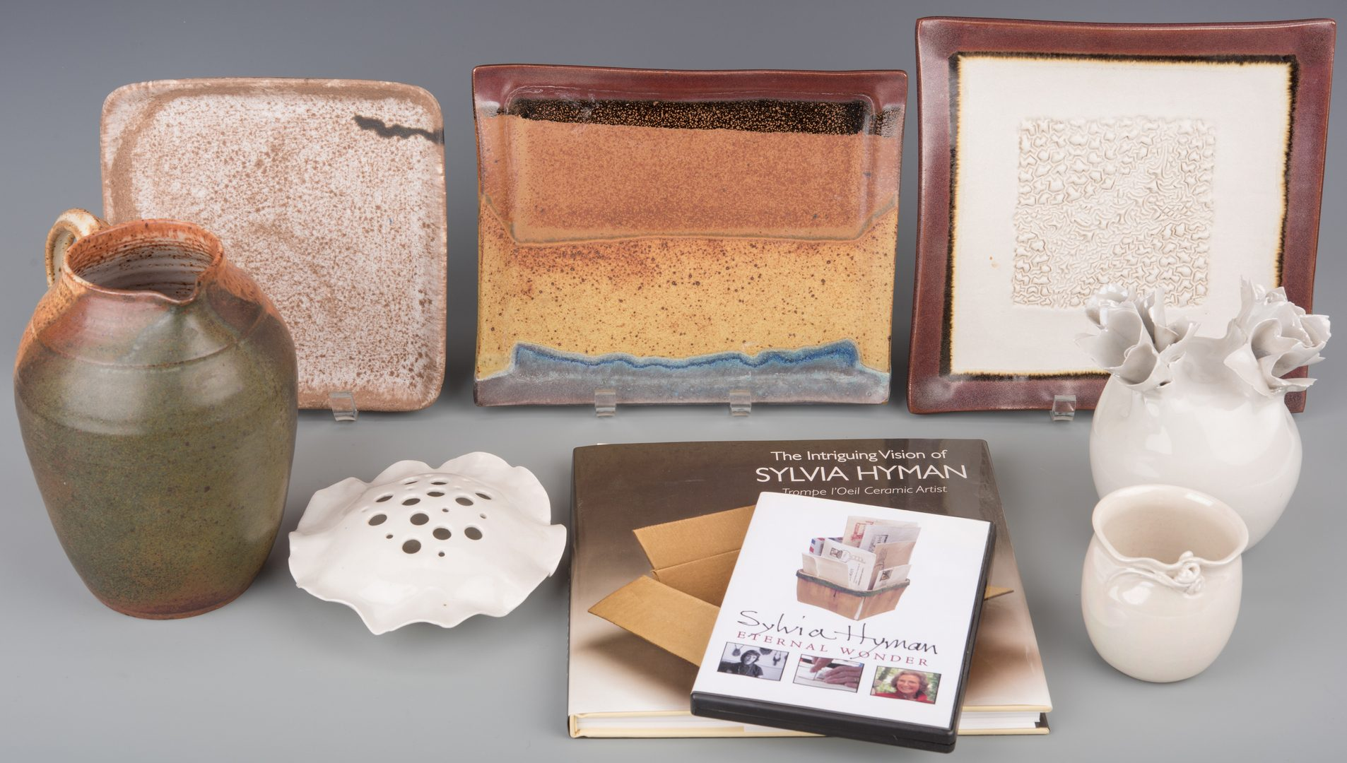 Lot 408: 7 Sylvia Hyman Ceramic Items & Book