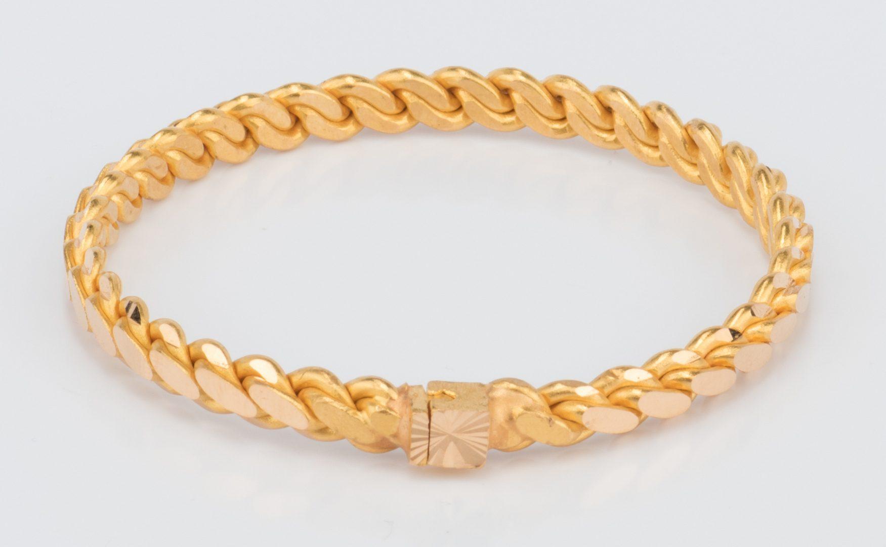 Lot 56: 24 ct Gold Bangle, 50 grams