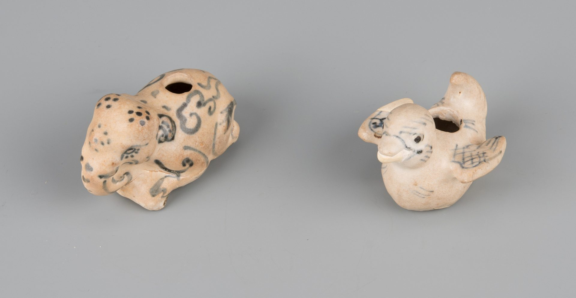 Lot 585: 4 Figural Ceramic Water Droppers