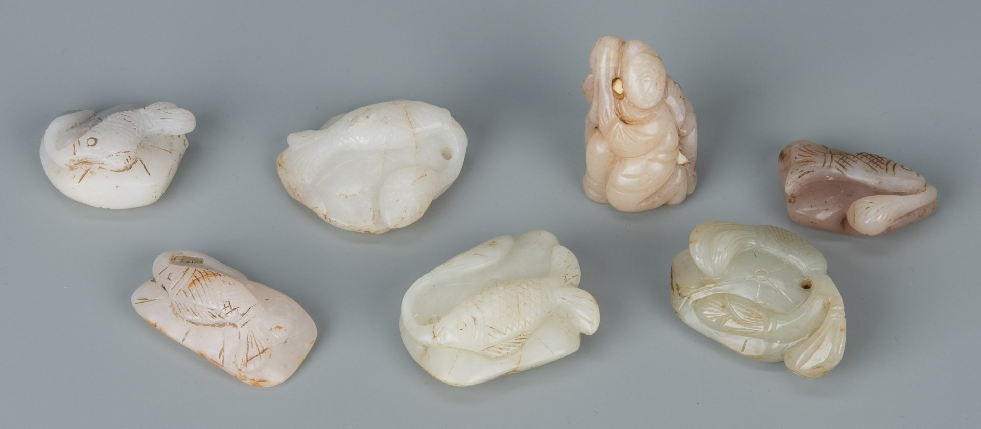 Lot 586: 7 Chinese Jade Toggles, incl. Fish