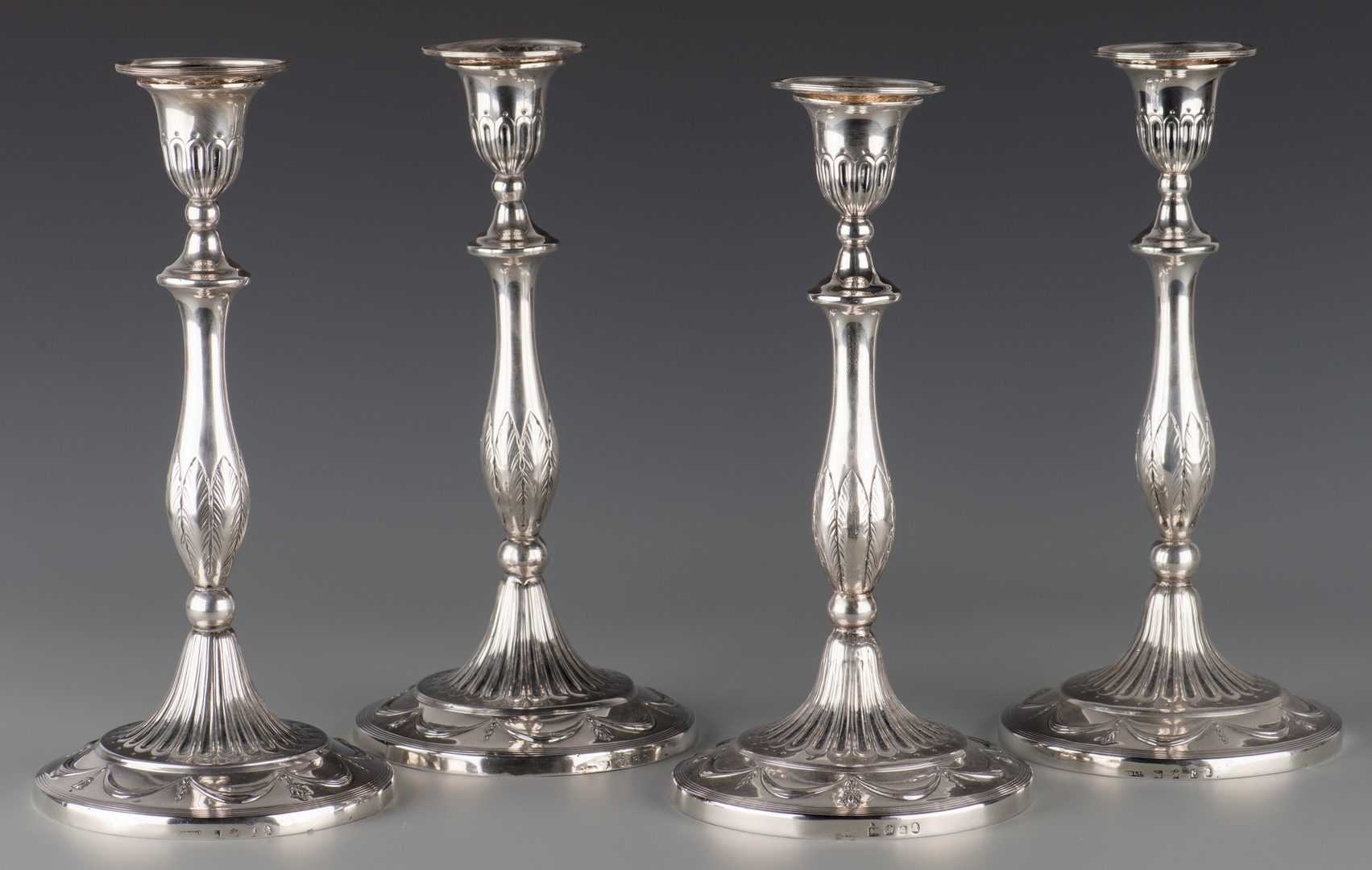 Lot 63: 4 George III Sterling Candlesticks