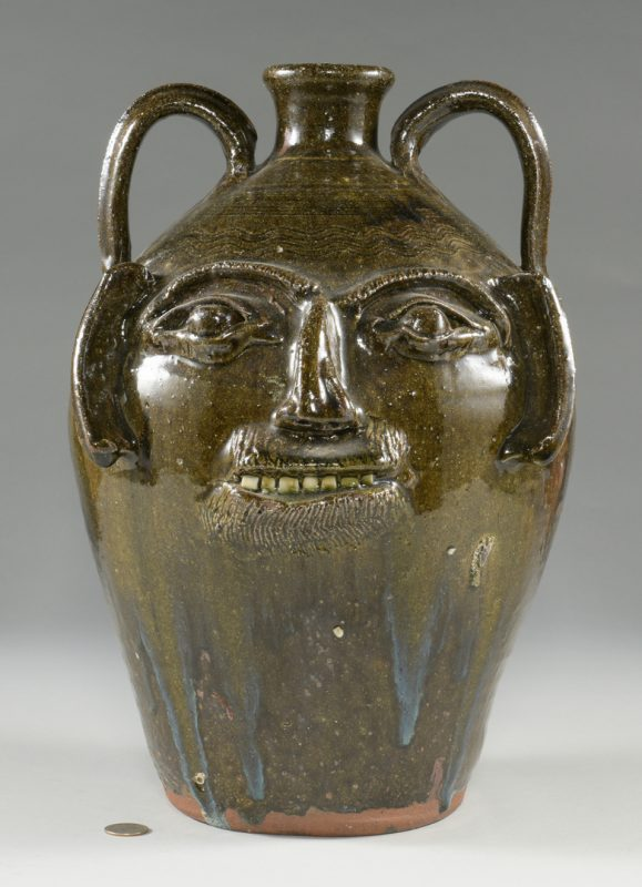 Lot 667: Large Burlon B. Craig folk art pottery face jug