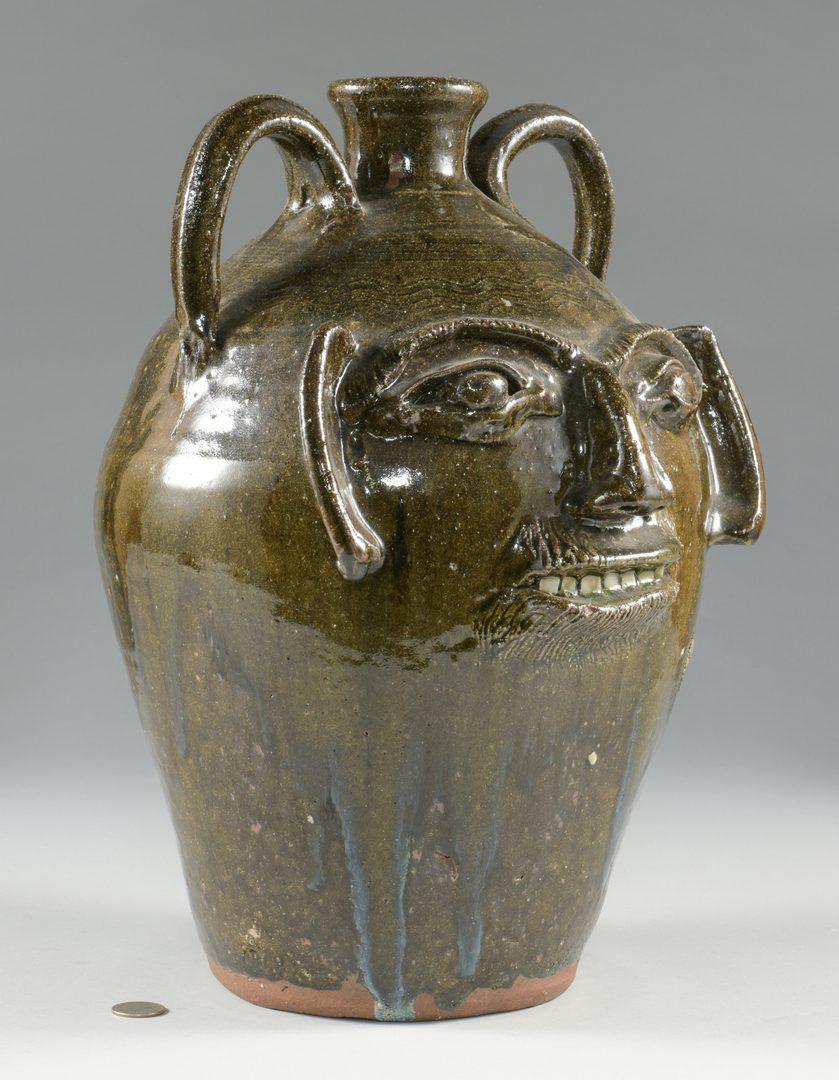 Lot 667: Large Burlon B. Craig folk art pottery face jug