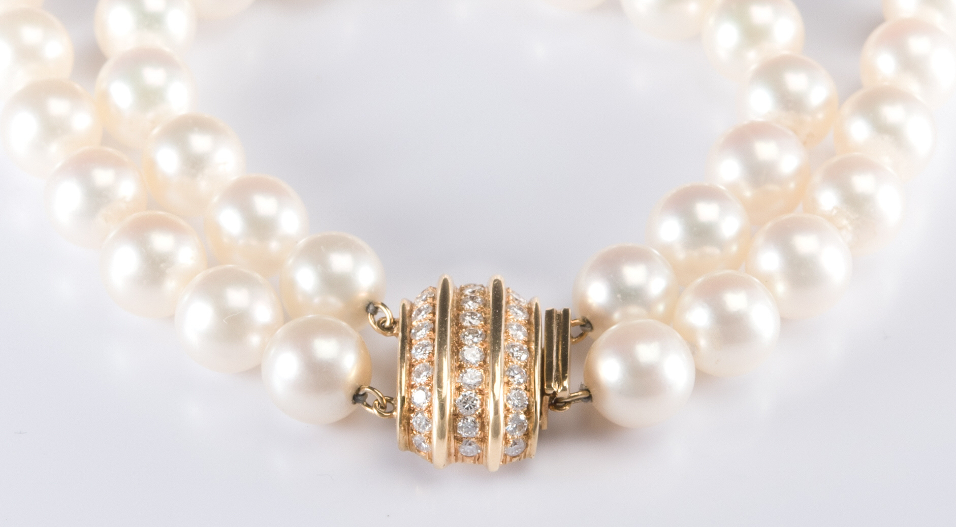 Lot 707: 8 mm Pearls, 14K Diamond Clasp