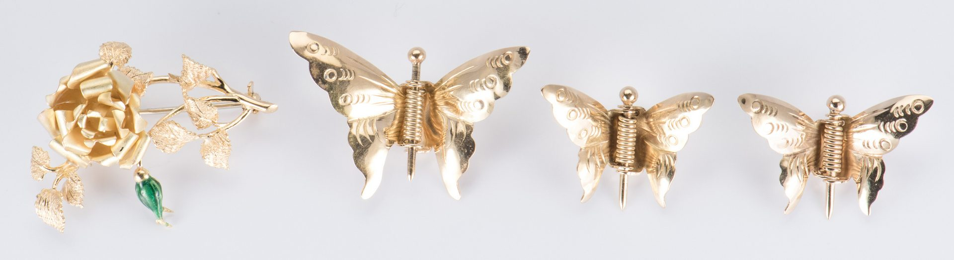 Lot 715: 4 Gold Pins incl Butterflies