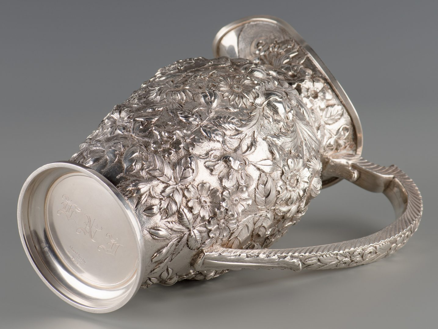 Lot 71: Kirk Sterling Repousse Water Pitcher