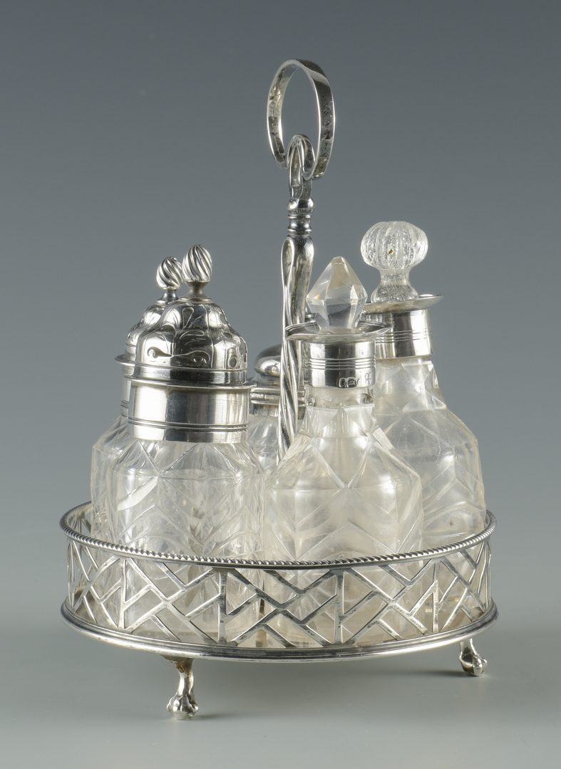 Lot 735: Irish Sterling Ladle, George III Cruet Set