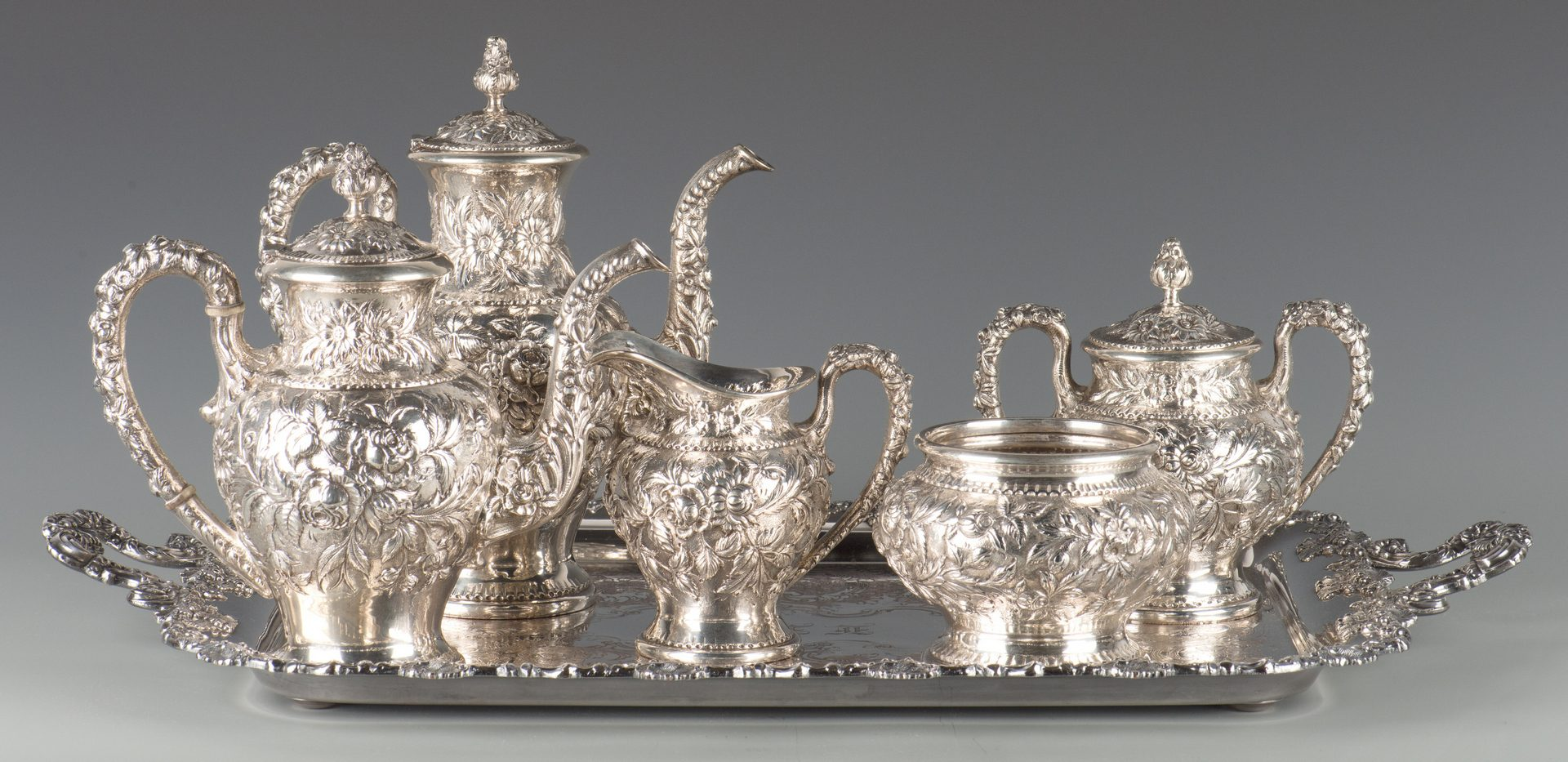 Lot 73: Kirk Repousse Sterling Tea Set, 5 pcs.