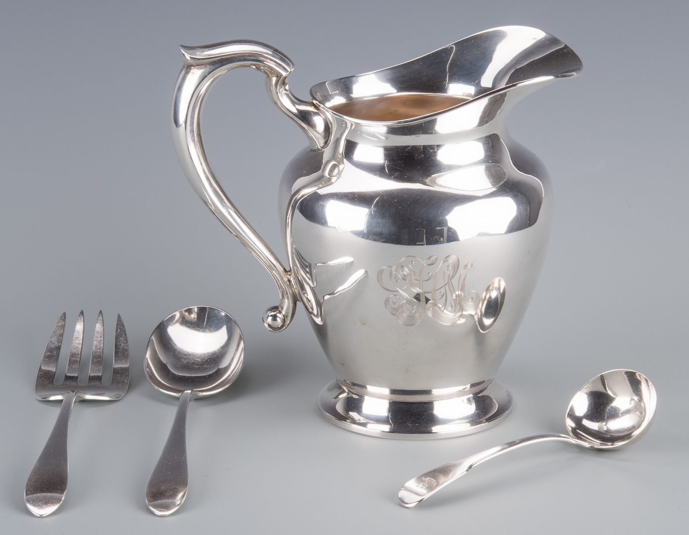 Lot 751: Sterling Pitcher and 3 pcs Flatware