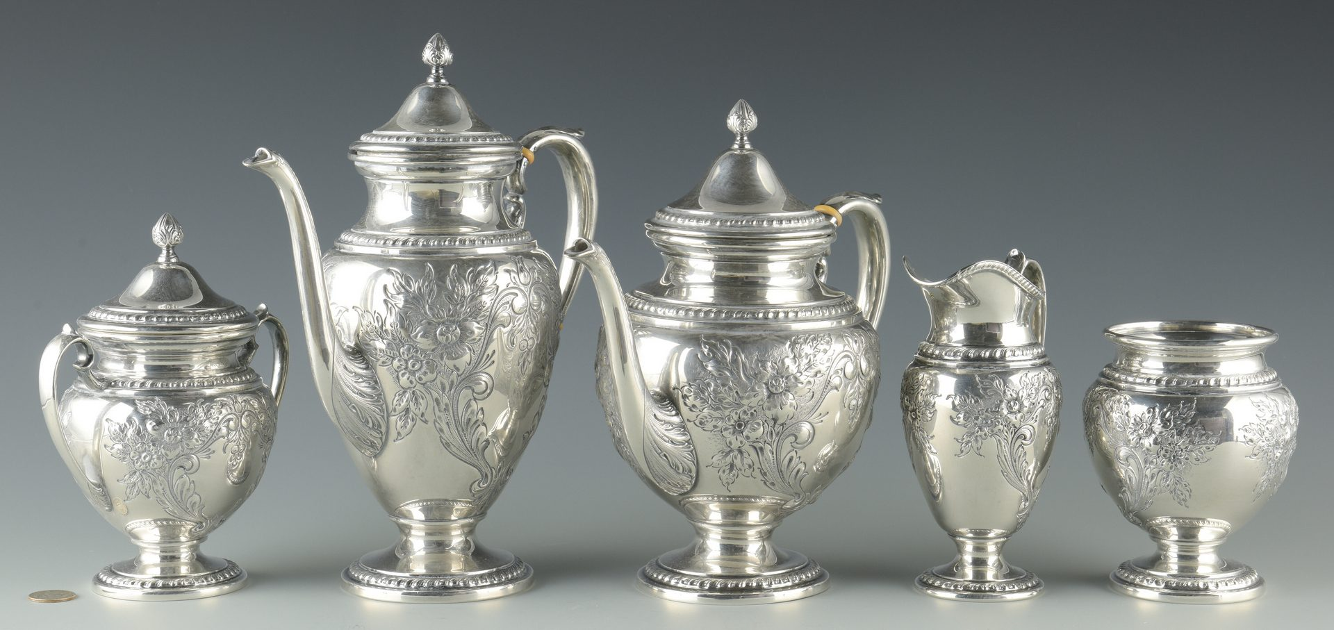 Lot 80: Whiting Lily-Floral 5 pc. Sterling Tea Service