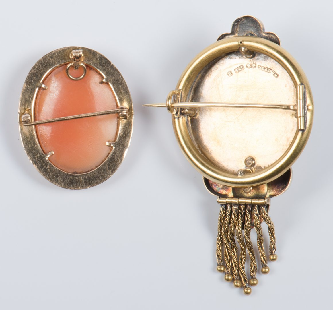 Lot 889: 18K Victorian Brooch and 10K cameo