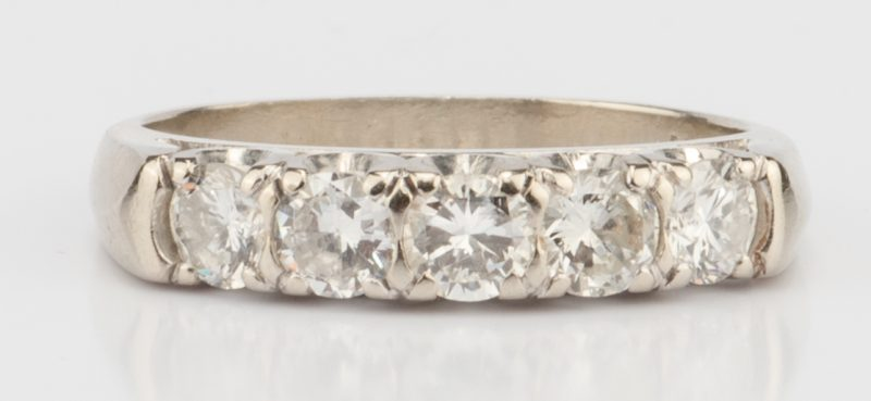 Lot 893: 14K 5 stone Diamond Band