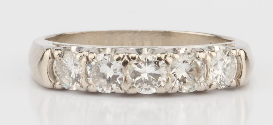 Lot 893: 14K 5 stone Diamond Band