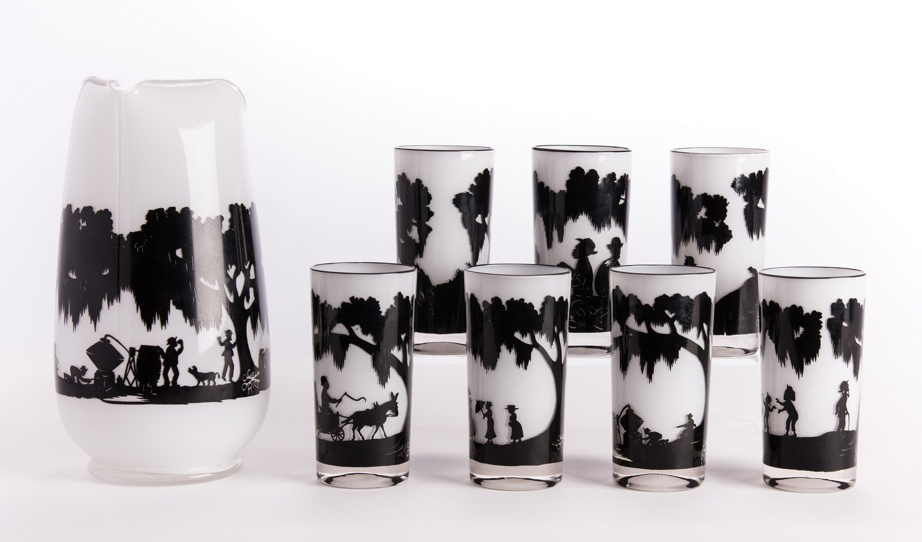 Lot 14: Carew Rice Silhouette Pitcher & 7 Glasses