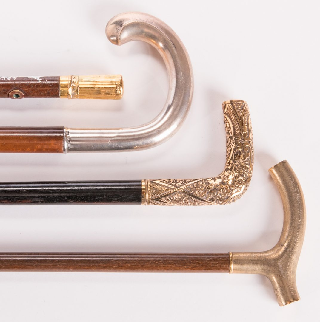 Lot 186: 4 Silver & Gold Metal-handled Walking Sticks