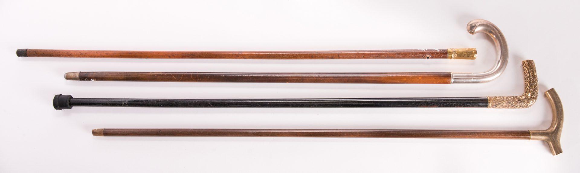 Lot 186: 4 Silver & Gold Metal-handled Walking Sticks