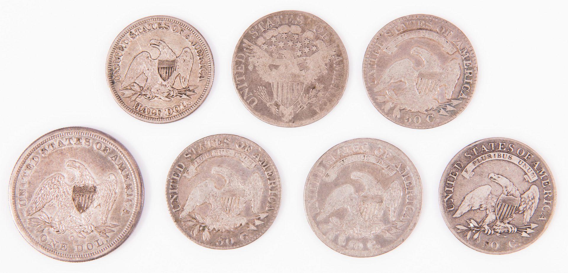 Lot 31: 1859 – O  $1 US Seated  Liberty & 6 Early US Liberty Half Silver Dollars