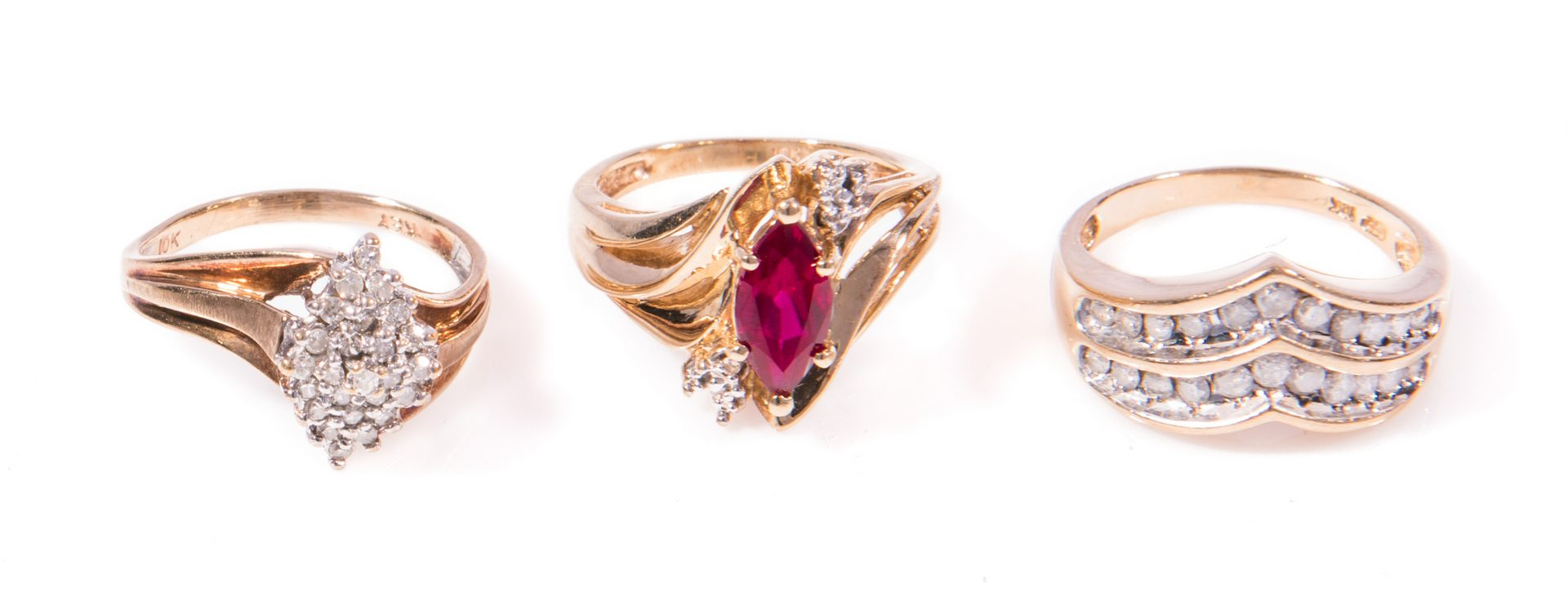 Lot 32: Group of 5 Gold Cocktail Rings