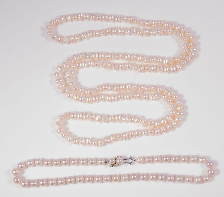 Lot 34: 2 strands pearls