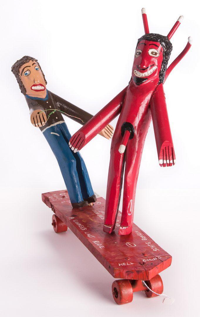 "Lot 84: Ronald Cooper Folk Art Sculpture ""Scate Bordin to Hell"""