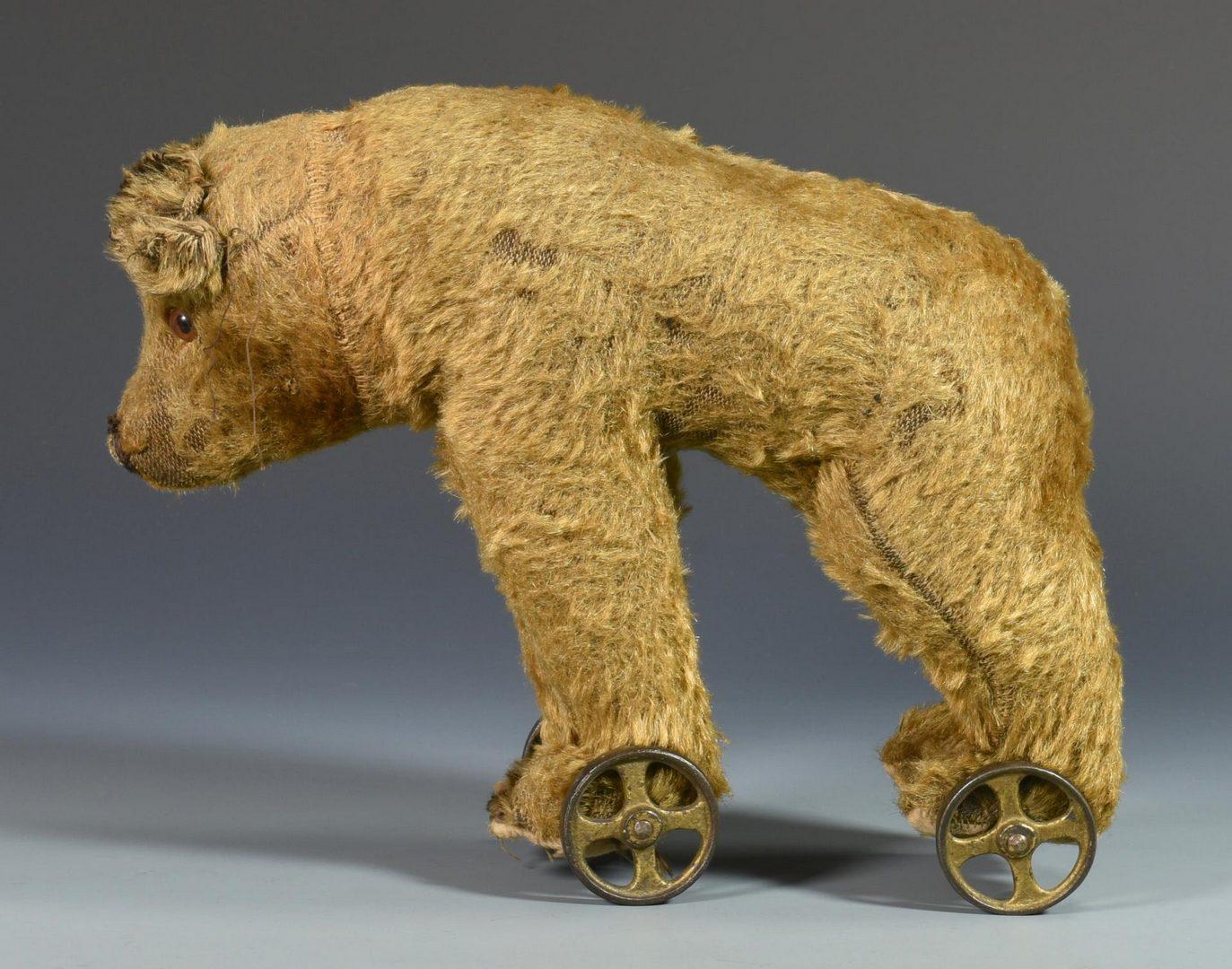 Lot 90: 2 German Wheel Toys, Folk Art Portrait, & Burke Candle Mold