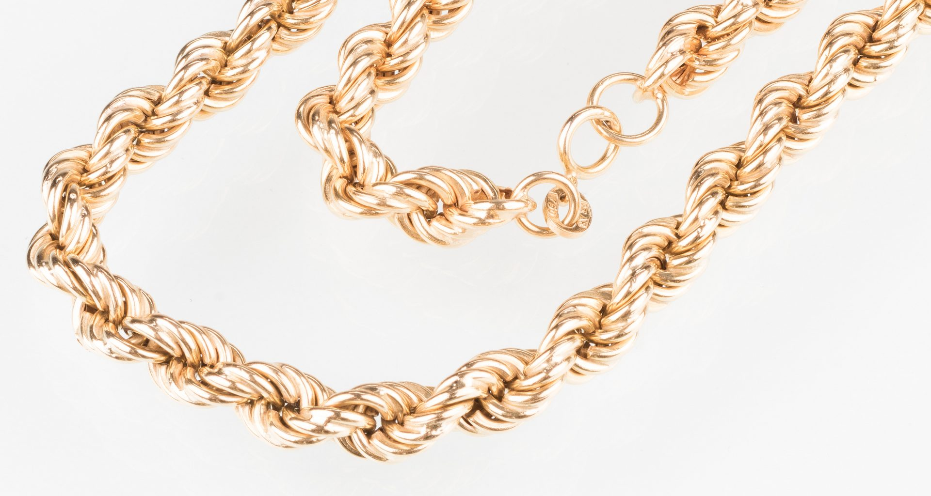 "Lot 245: 18K 32"" L Rope Necklace, 42.4 grams"