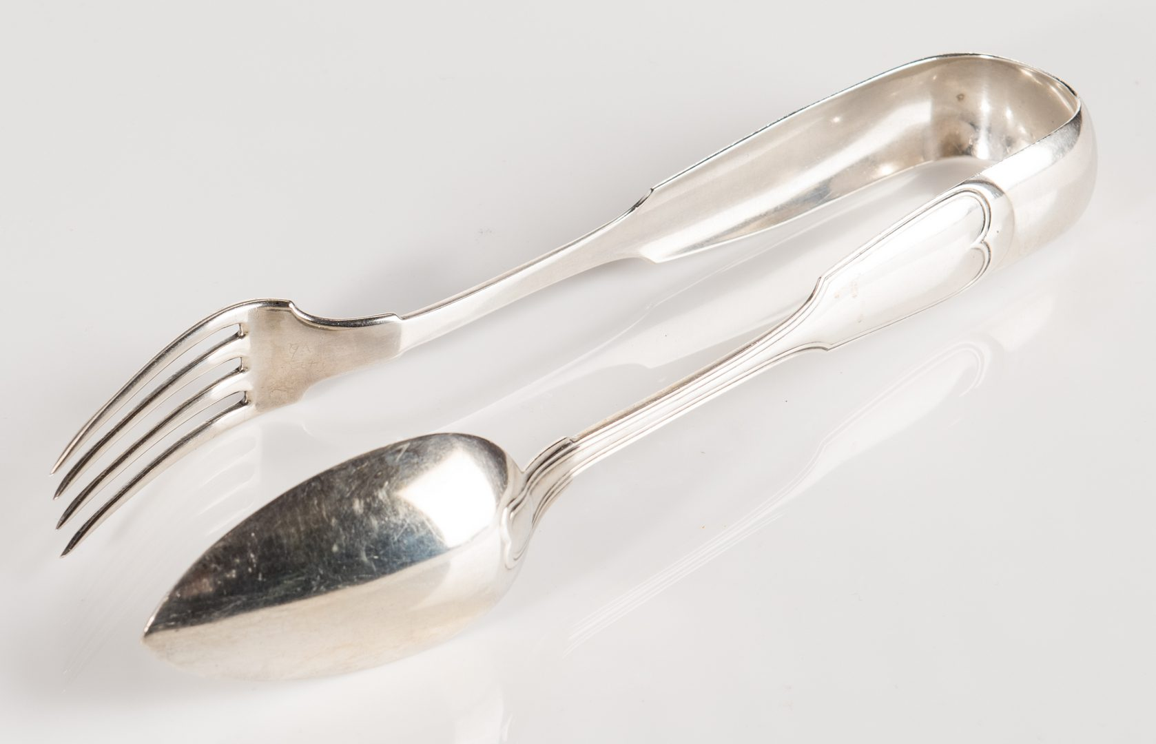 Lot 287: New Orleans Coin Silver Fried Chicken Tongs