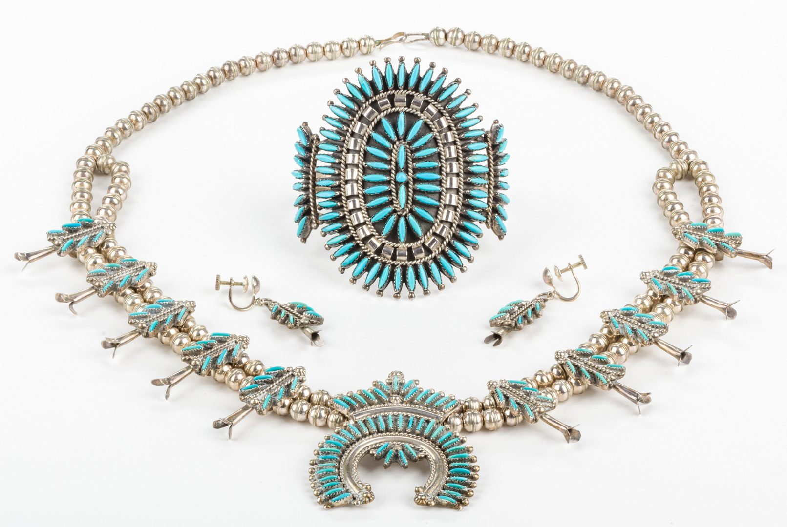 Lot 395: Zuni Needlepoint Necklace, Earrings, Cuff