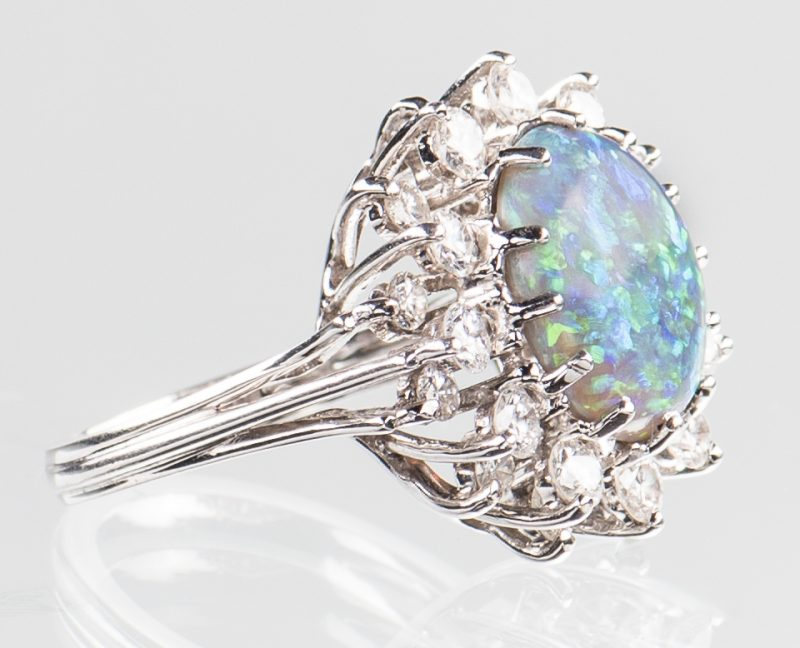 Lot 50: 10 ct Lightening Ridge Opal Diamond Ring