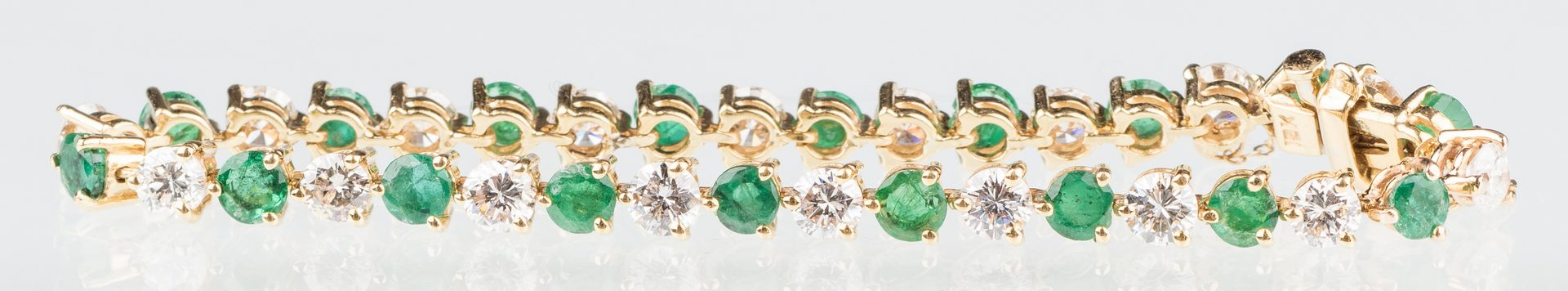 Lot 51: 18K Emerald & Diamond Bracelet