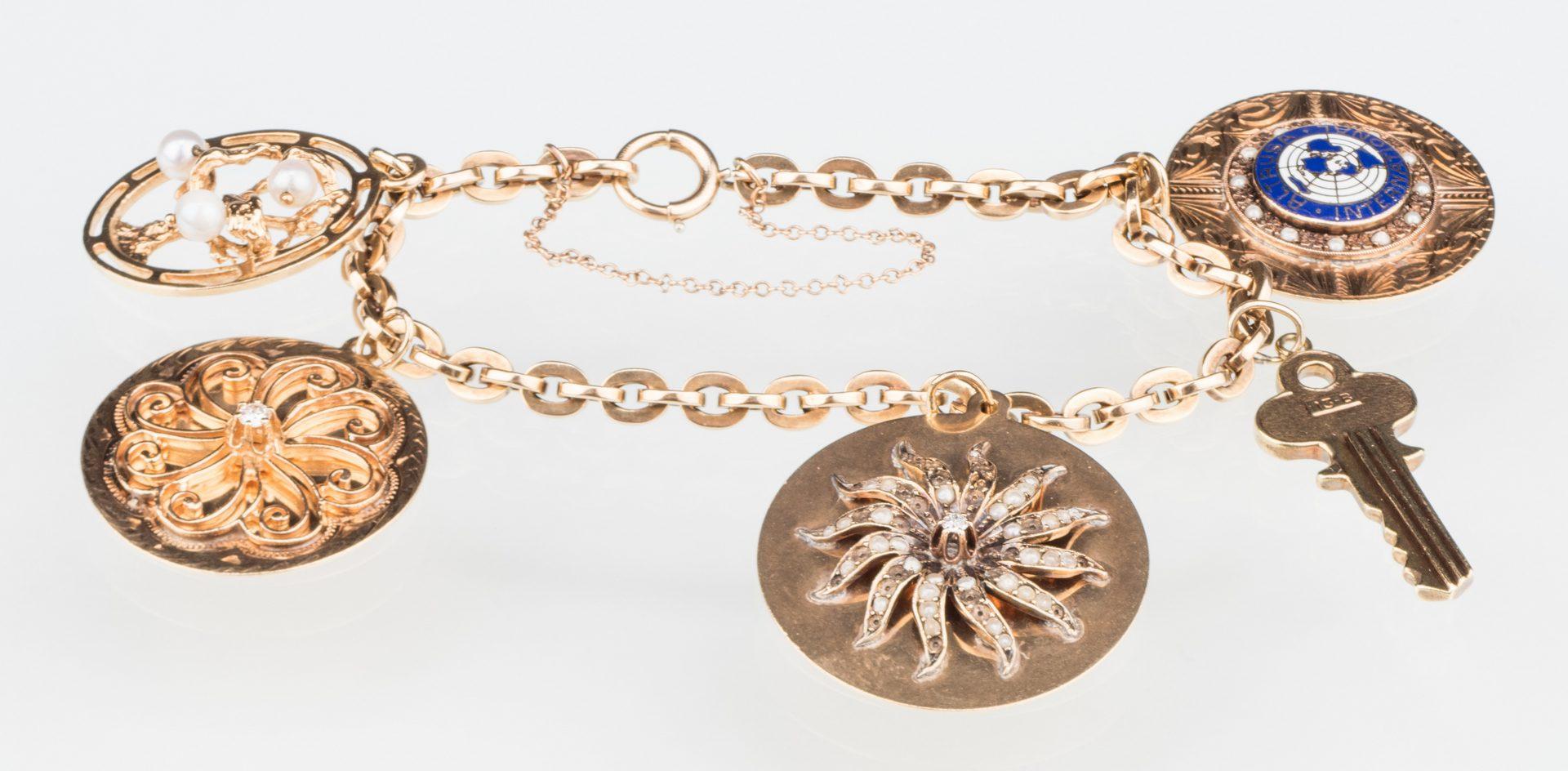 Lot 529: 10K Gold Charm Bracelet, 14K charms