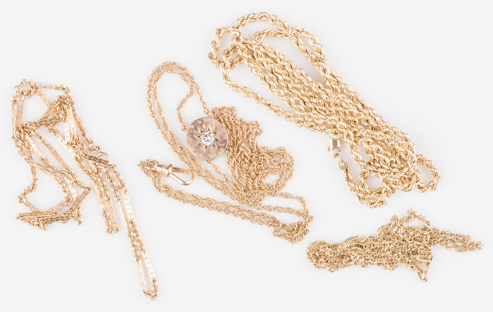 Lot 535: Four 14K Chains inc. watch chain