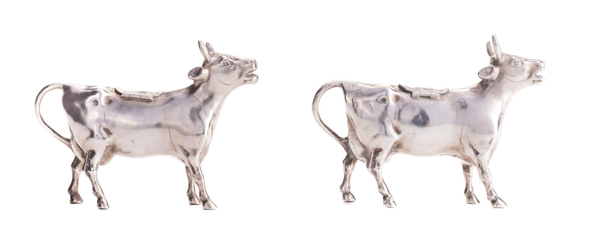 Lot 554: Two German 835 Silver Cow Creamers