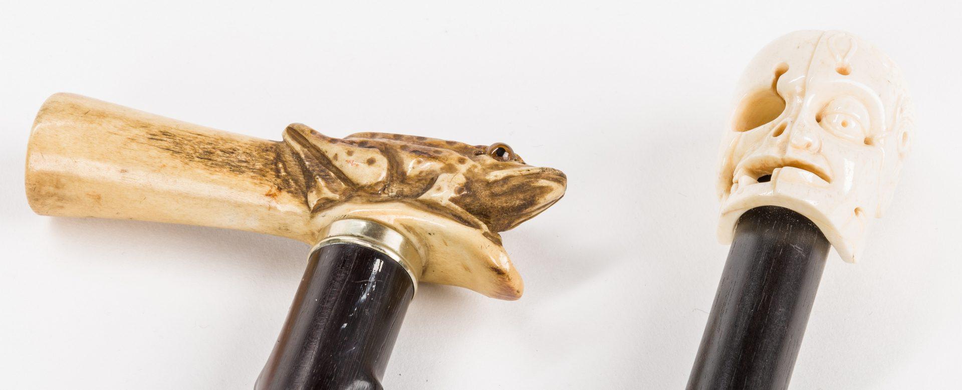 Lot 656: 2 Asian Frog and Skull Walking Sticks