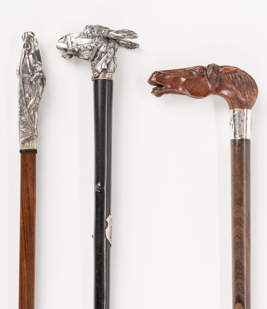 Lot 715: 3 Equine related walking sticks