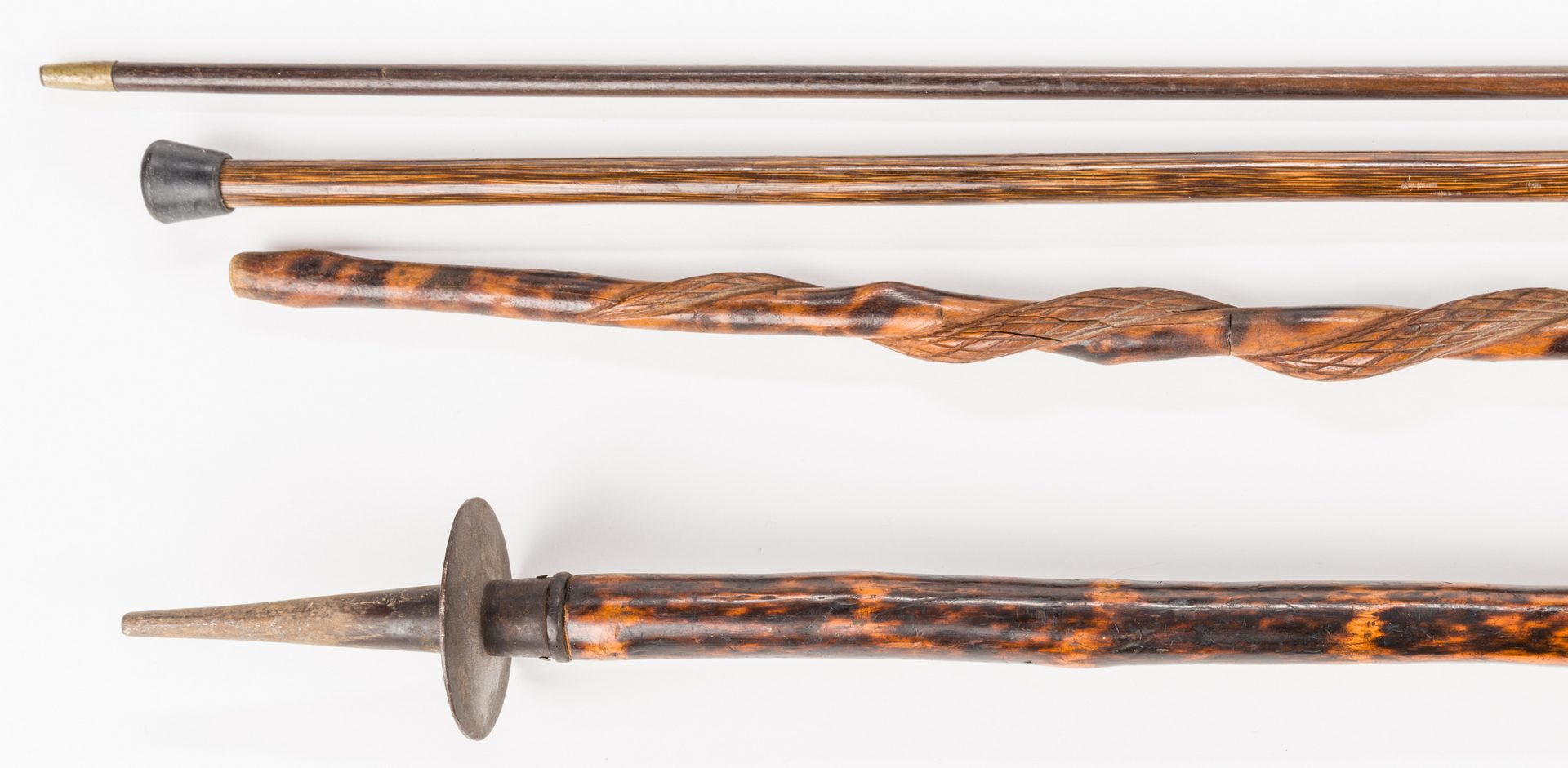 Lot 720: 3 Carved Canes & Victorian Shooting Stick, 4 items