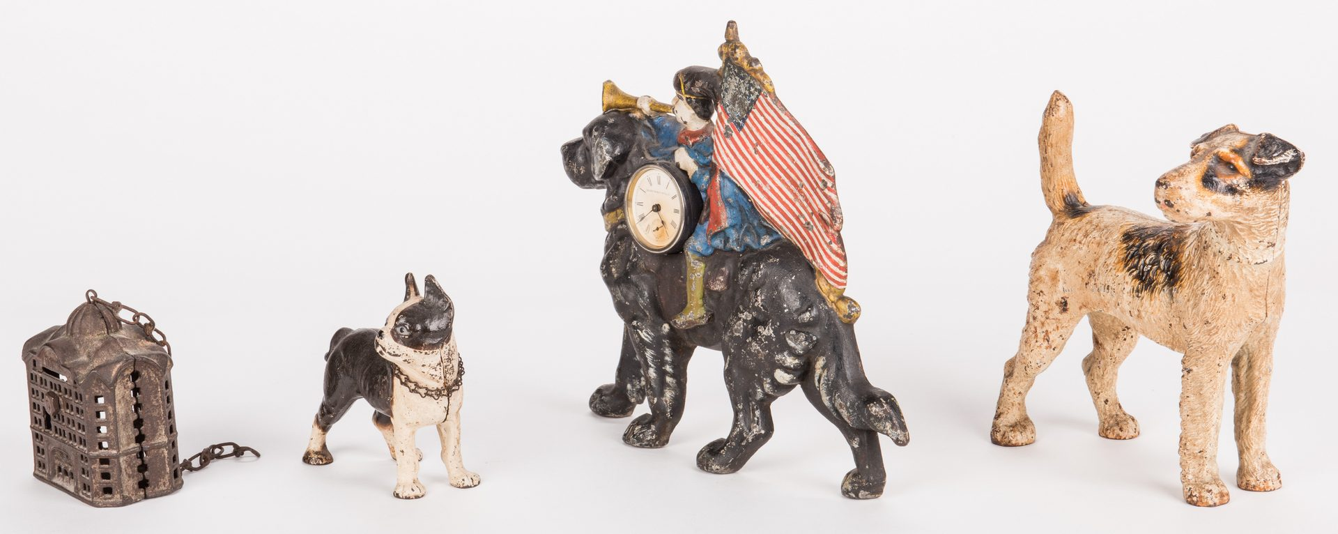 Lot 818: 4 Figural Cast Iron Items