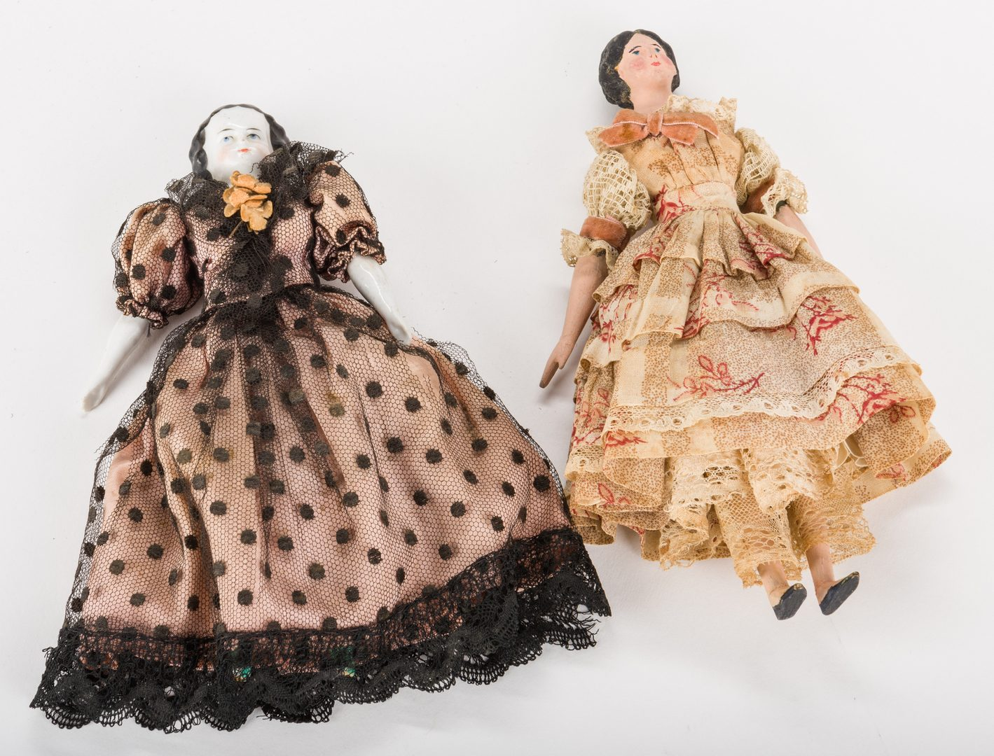 Lot 825: Dressmaker's Model Doll and small China Doll