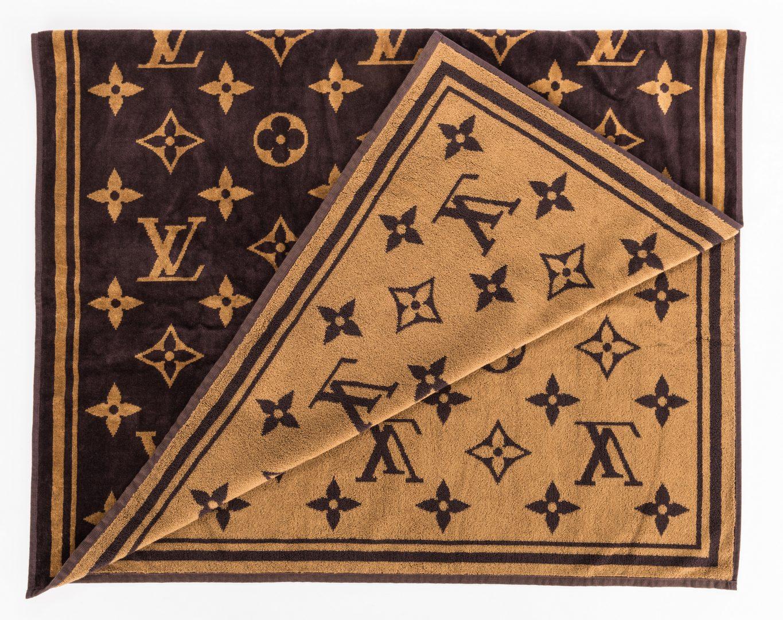 Lot 832: 4 Designor Louis Vuitton Items & 3 Related Books