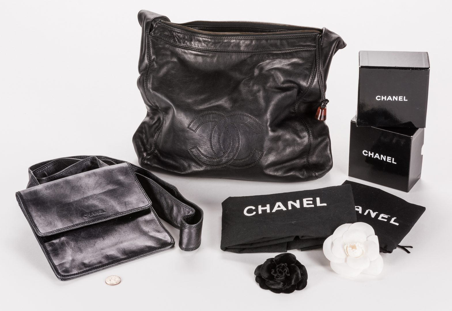 Lot 838: 2 Chanel handbags/2 Chanel pins