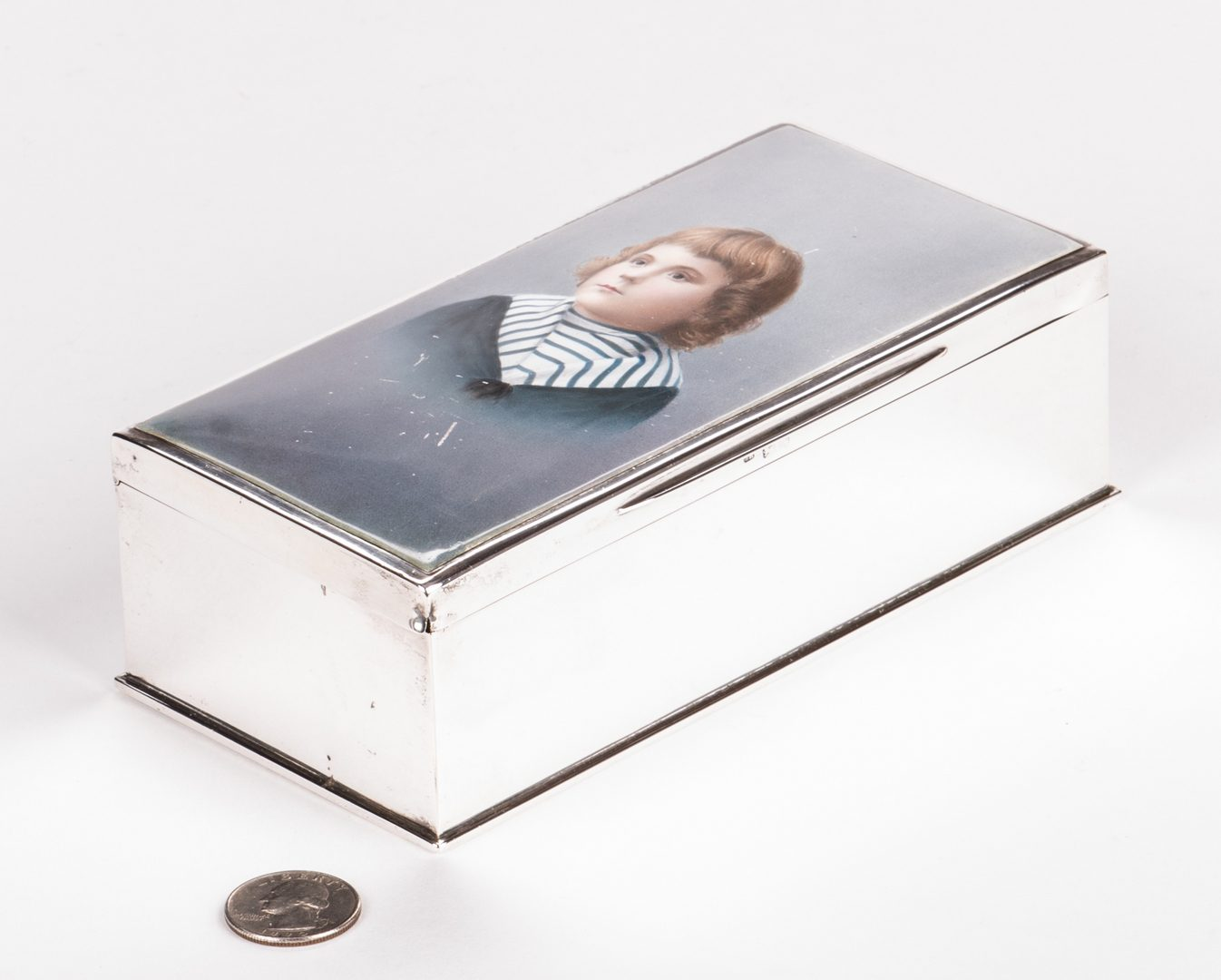 Lot 877: Sterling and Porcelain Child Portrait Box