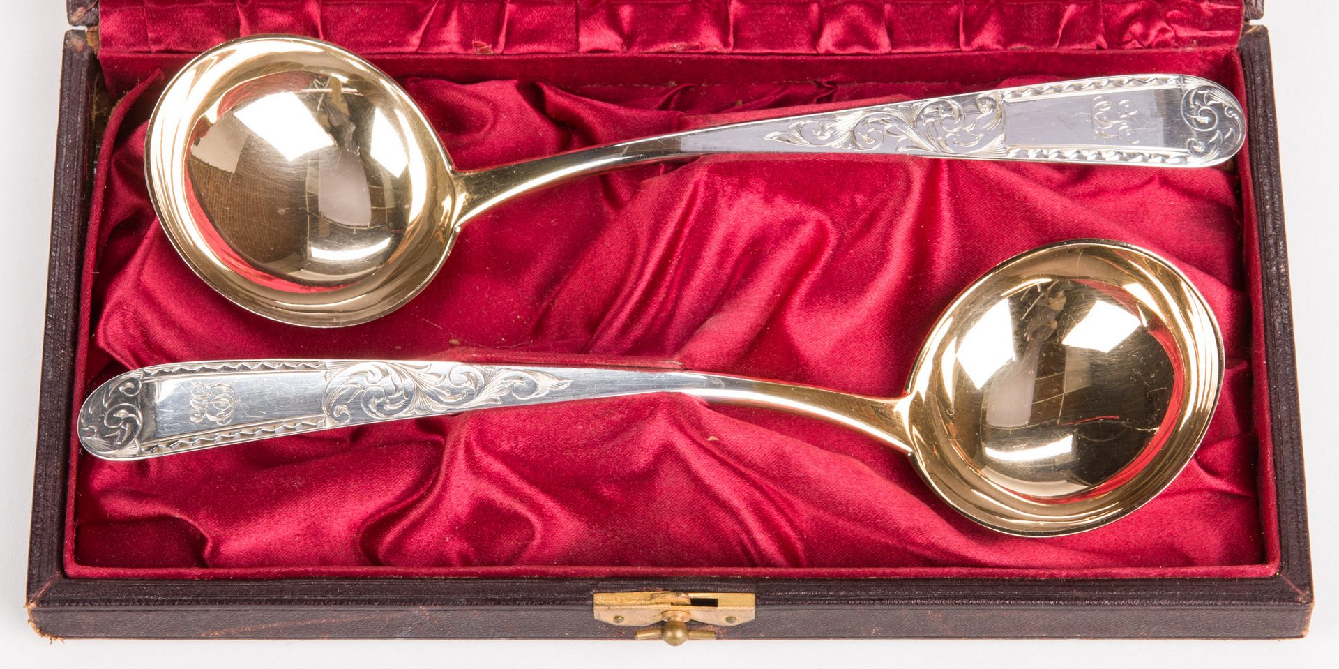 Lot 883: Pair Cased S. Kirk & Son Silver Ladles